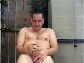 Wanking my oiled shaft outdoors in the garden