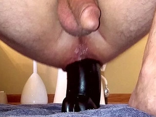 Squatting on a big dildo